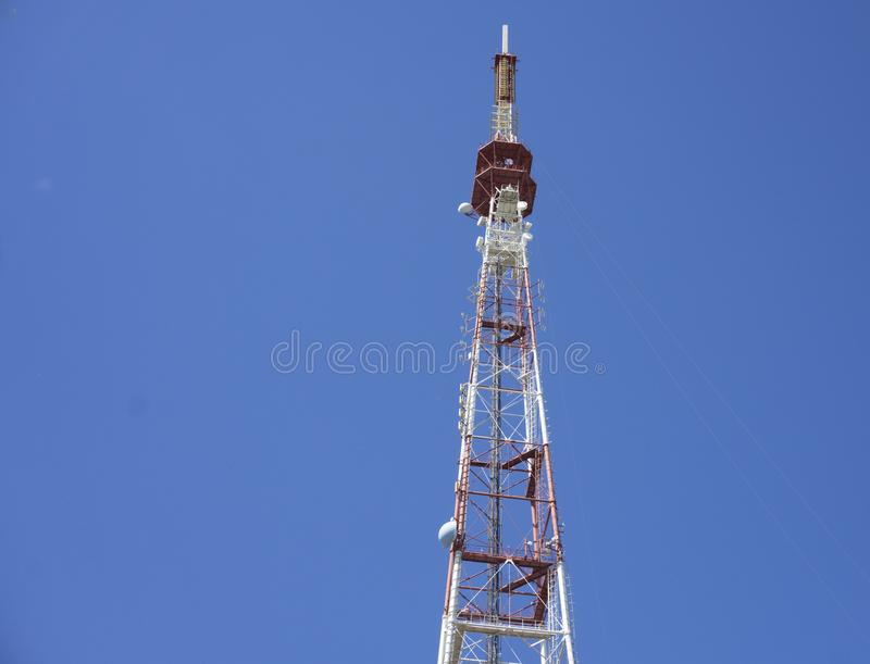 Telecommunication tower with antennas with blue sky royalty free stock photo