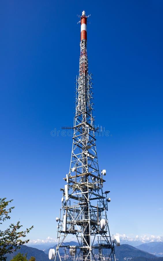 Telecommunication tower with antennas over Monte San Salvatore, Lugano, Switzerland. Telecommunication tower with antennas over Monte San Salvatore royalty free stock image