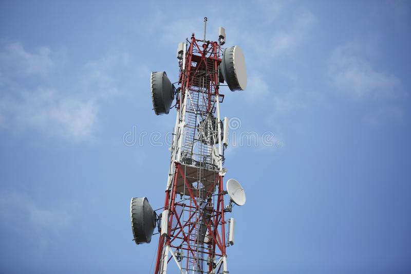 Telecommunication tower with antennas stock images