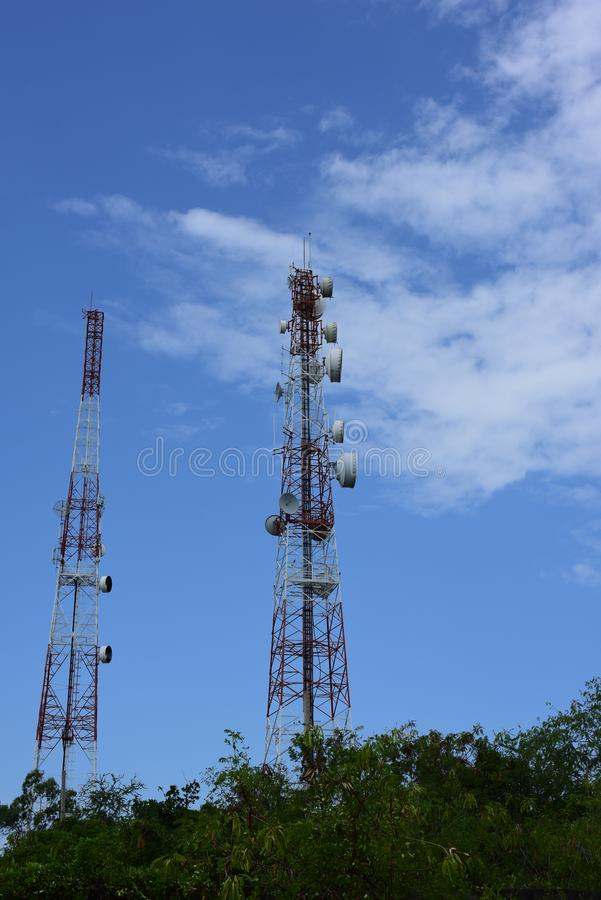 Telecommunication tower with antennas. Wireless Communication Antenna With bright sky.Telecommunication tower with antennas.High pole for signal transmission royalty free stock image