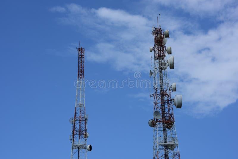 Telecommunication tower with antennas. Wireless Communication Antenna With bright sky.Telecommunication tower with antennas.High pole for signal transmission stock photos