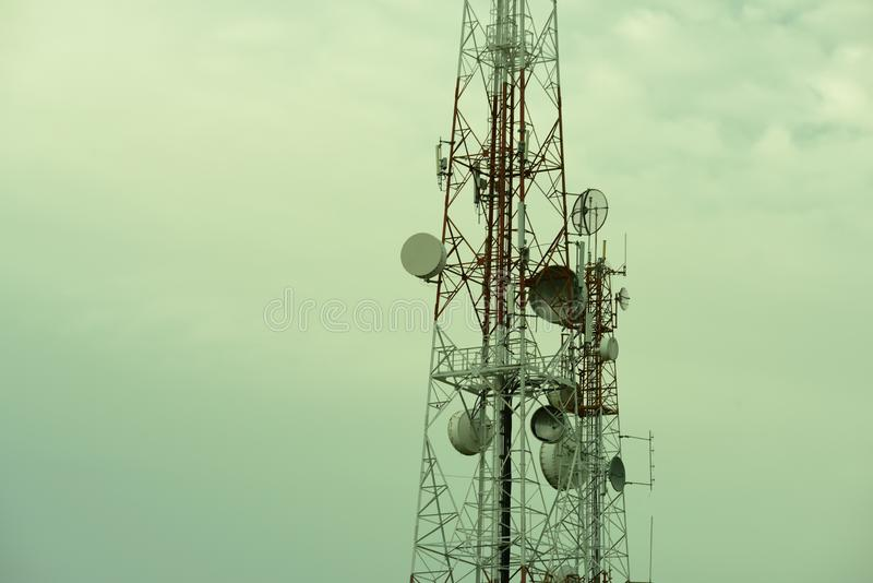 Telecommunication tower with antennas. Wireless Communication Antenna With bright sky.Telecommunication tower with antennas.High pole for signal transmission royalty free stock photos