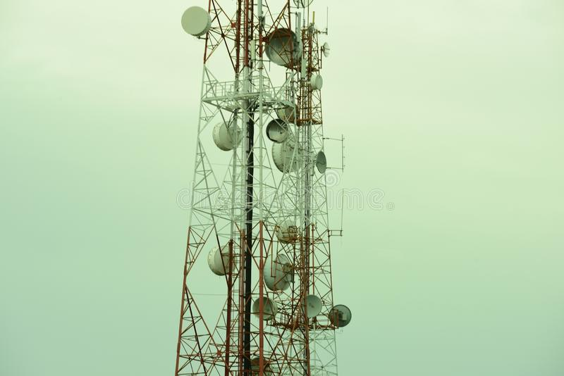 Telecommunication tower with antennas. Wireless Communication Antenna With bright sky.Telecommunication tower with antennas.High pole for signal transmission stock images