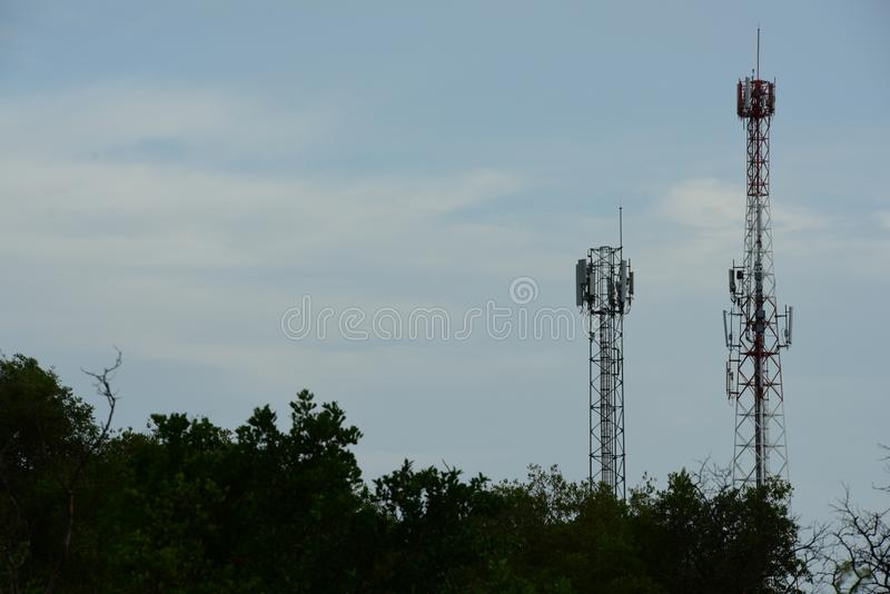 Telecommunication tower with antennas. Wireless Communication Antenna With bright sky.Telecommunication tower with antennas.High pole for signal transmission royalty free stock images