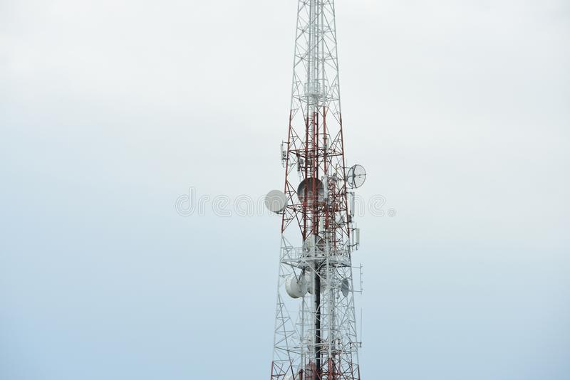 Telecommunication tower with antennas. Wireless Communication Antenna With bright sky.Telecommunication tower with antennas.High pole for signal transmission stock photography