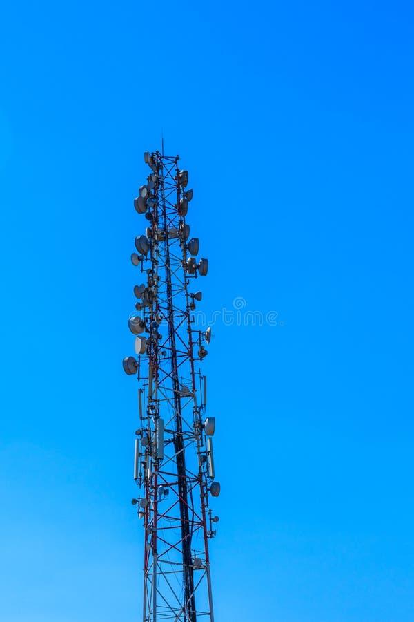 Telecommunication tower with the antennas or wireless Communication antenna transmitter against blue sky. Telecommunication tower with antennas or wireless stock image
