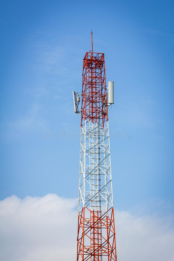Telecommunication tower and background of cloudy blue sky. royalty free stock photo