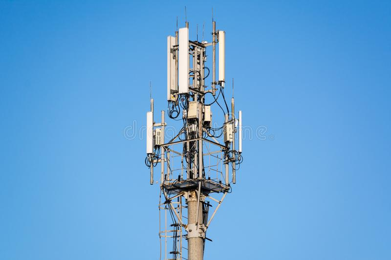 The telecommunication tower. In with the blue sky royalty free stock images
