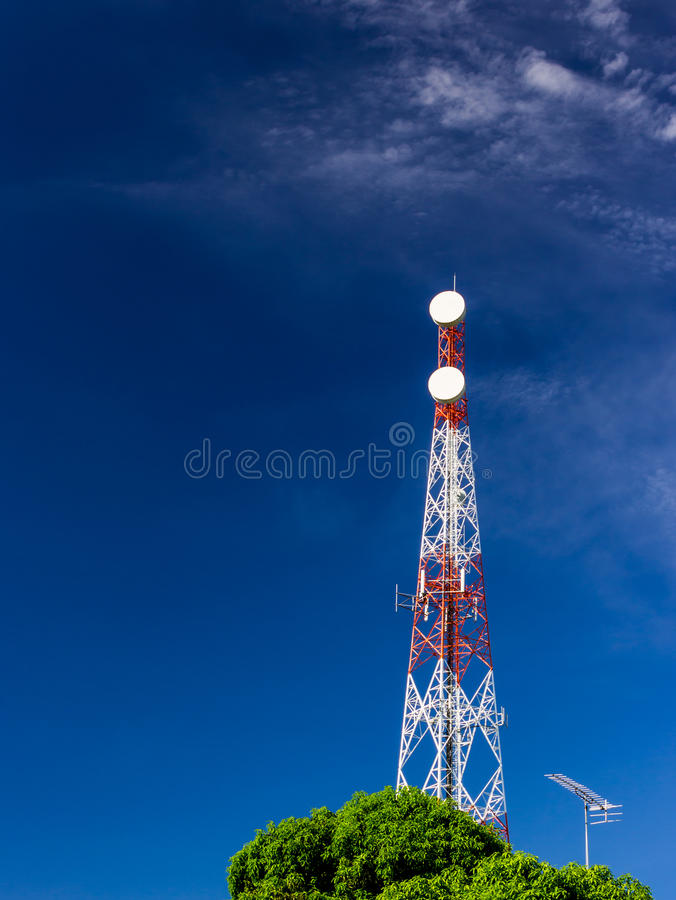 Telecommunication tower. And blue sky stock image