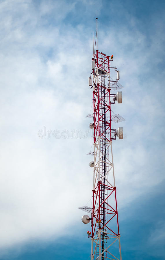 Telecommunication tower. On blue sky royalty free stock photography