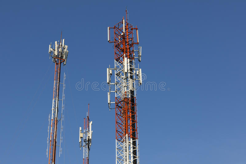 Telecommunication tower. With blue sky royalty free stock photos