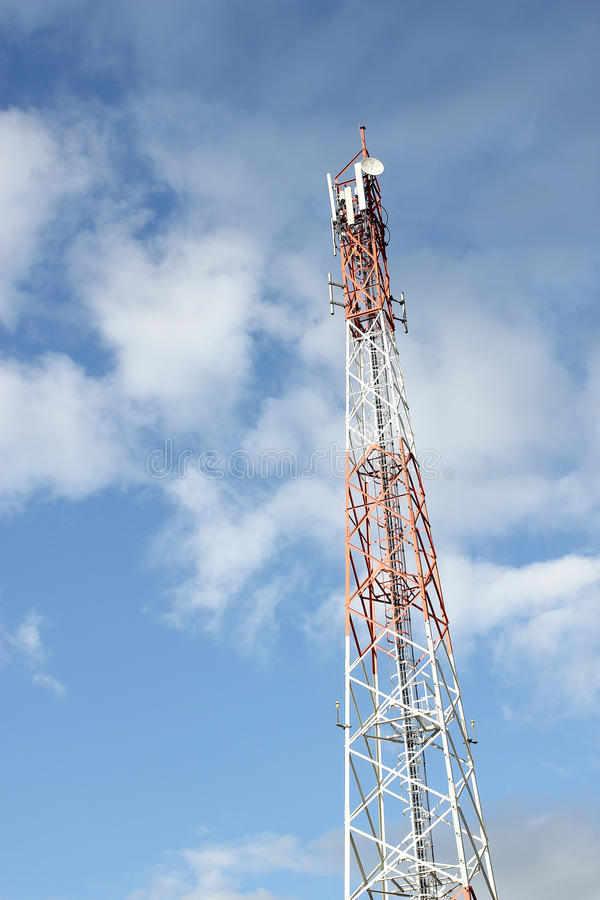 Telecommunication tower with blue sky.  stock photos