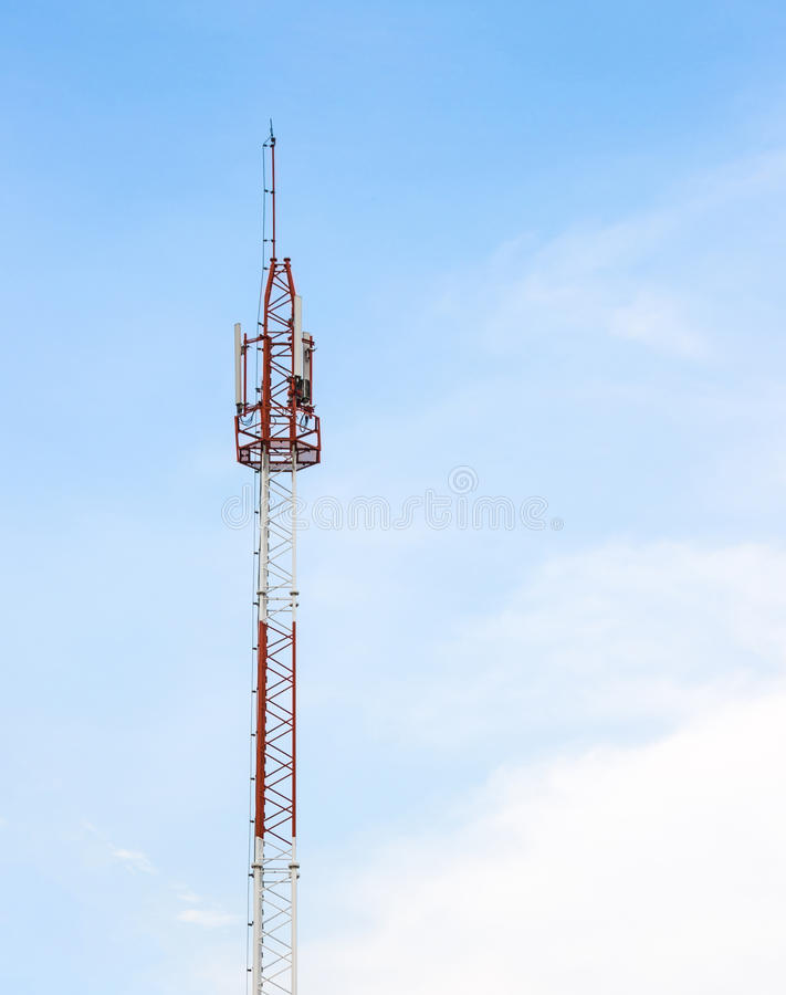 Telecommunication tower. On blue sky background royalty free stock photography