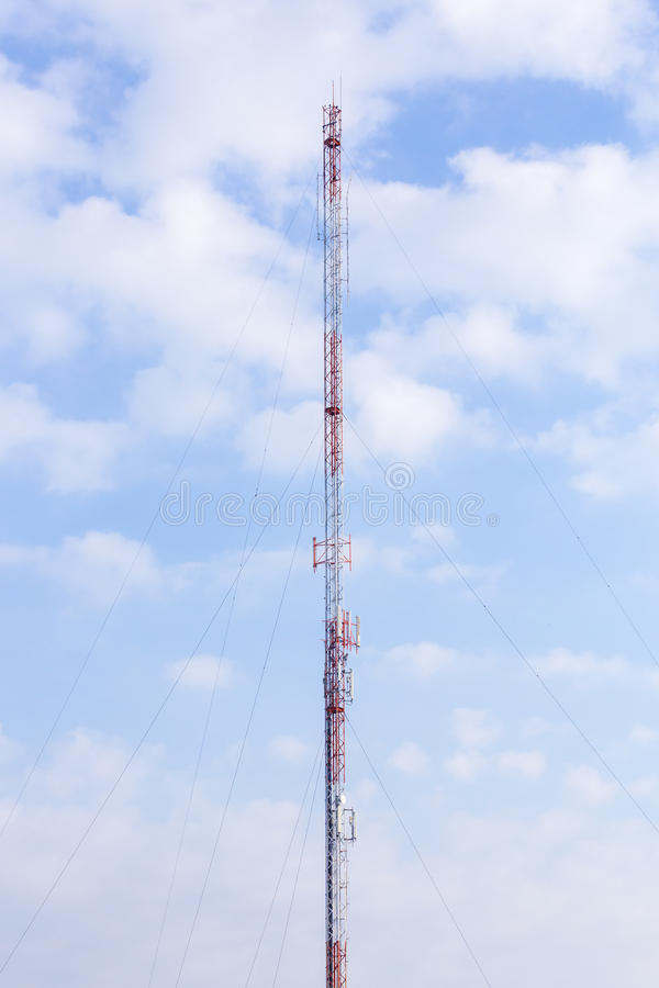 Telecommunication tower with blue sky background. Telecommunication tower with blue sky background stock photography