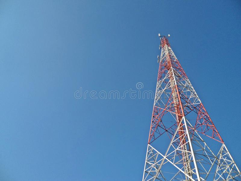 Telecommunication tower on blue sky background.  royalty free stock photo