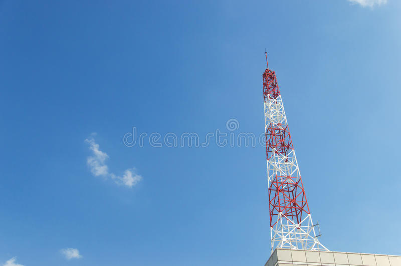Telecommunication tower on blue sky blank background. Used to transmit television and telephony signal royalty free stock photos