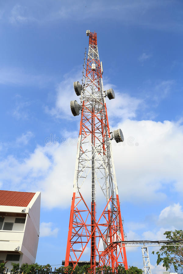 Telecommunication tower with blue sky and cloud, as background. stock photos