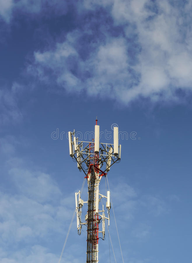 Telecommunication tower with blue sky and cloud. Red and White Telecommunication tower with sky and cloud royalty free stock photos