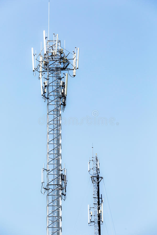 Telecommunication tower on blue sky. High telecommunication tower on the sky royalty free stock photos