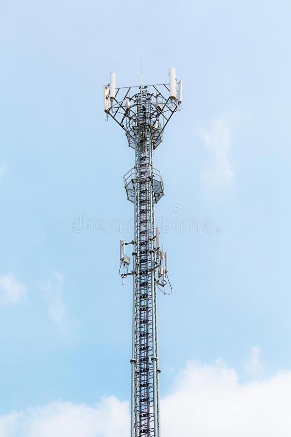 Telecommunication tower on blue sky. High telecommunication tower with the sky royalty free stock photo