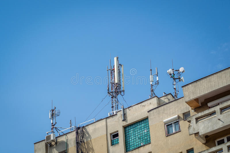 Telecommunication tower. On blue sky mounted on a flat stock images