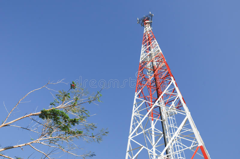 Telecommunication tower with blue sky. Telecommunication tower over a blue sky royalty free stock photography