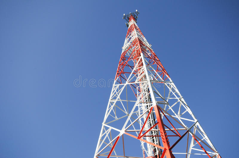Telecommunication tower with blue sky. Telecommunication tower over a blue sky royalty free stock photos