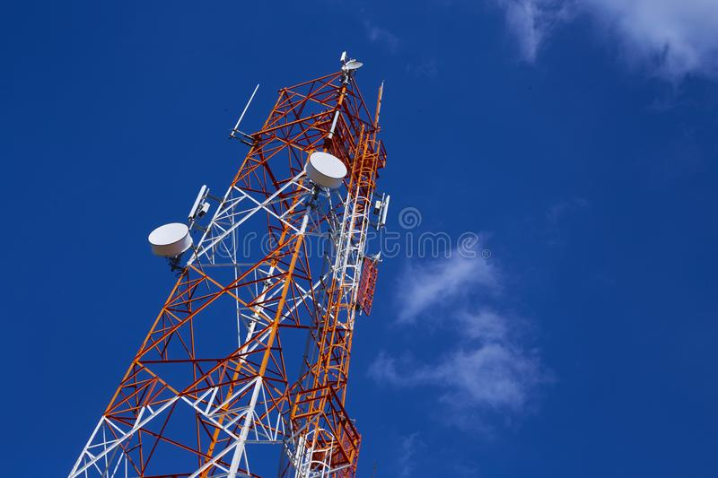 Telecommunication tower with blue sky stock photo
