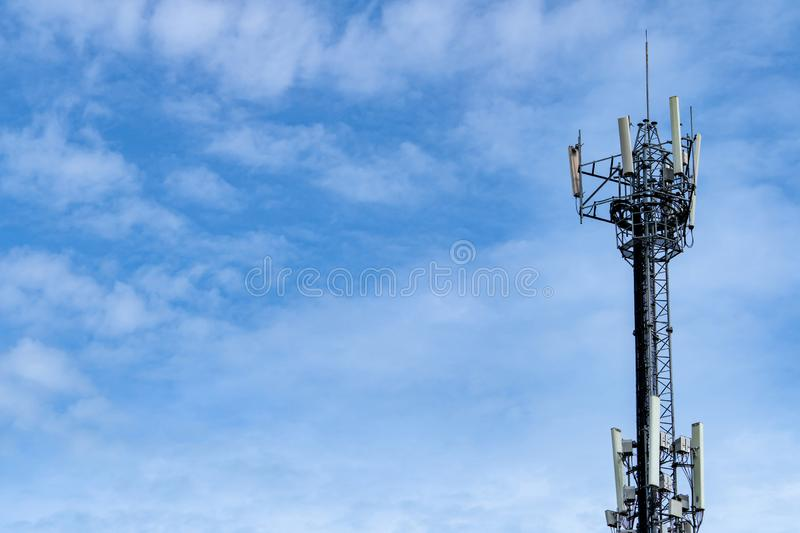 Telecommunication tower with blue sky and white clouds background. Antenna on blue sky. Radio and satellite pole. Communication. Technology. Telecommunication royalty free stock images
