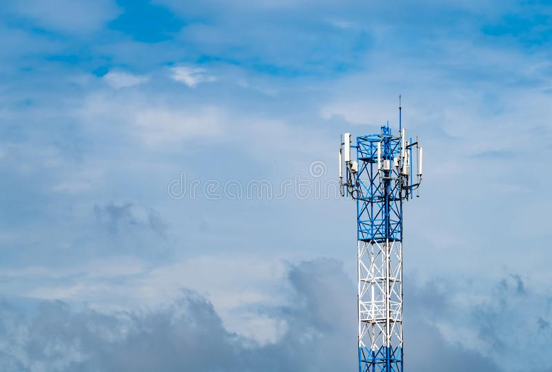Telecommunication tower with blue sky and white clouds background. Antenna on blue sky. Radio and satellite pole. Communication stock photos