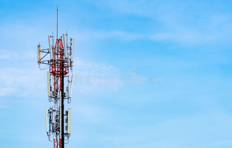 Telecommunication tower with blue sky and white clouds background. Antenna on blue sky. Radio and satellite pole. Communication. Technology. Telecommunication stock image