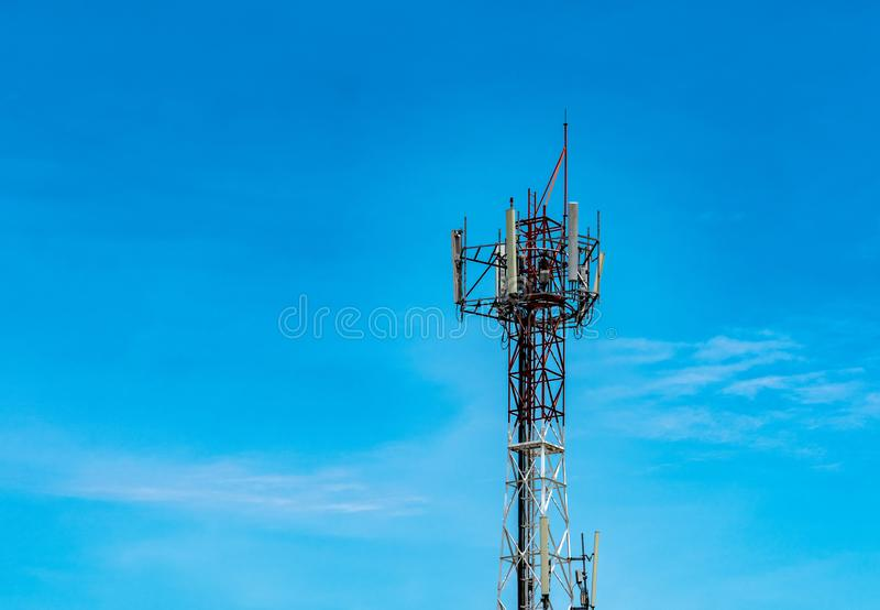 Telecommunication tower with blue sky and white clouds background. Antenna on blue sky. Radio and satellite pole. Communication stock photo