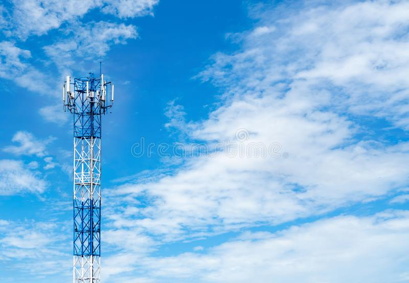 Telecommunication tower with blue sky and white clouds background. Antenna on blue sky. Radio and satellite pole. Communication. Technology. Telecommunication stock photos