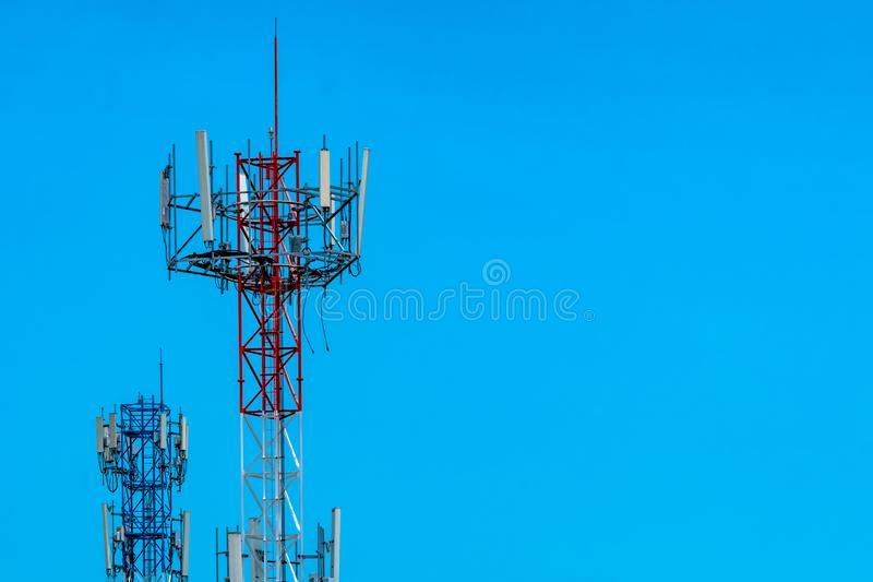 Telecommunication tower with blue sky and white clouds background. Antenna on blue sky. Radio and satellite pole. Communication stock photography
