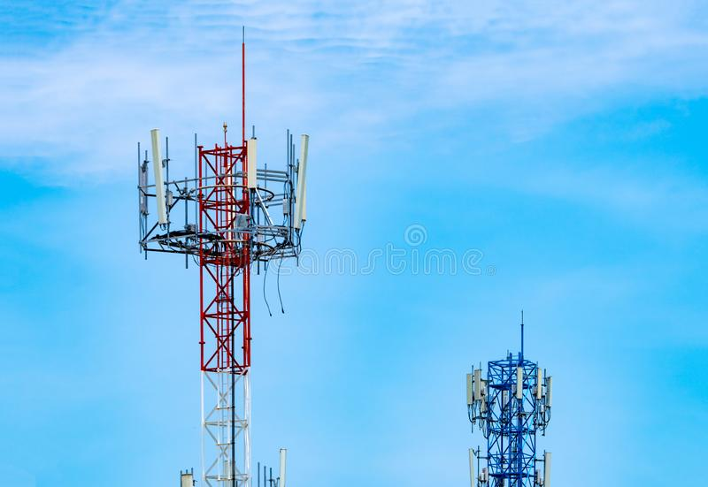 Telecommunication tower with blue sky and white clouds background. Antenna on blue sky. Radio and satellite pole. Communication royalty free stock photo