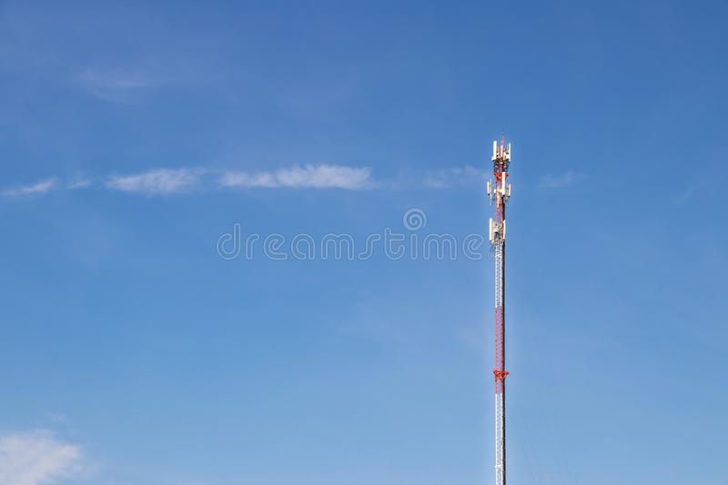 Telecommunication tower with blue sky and white clouds background,satellite pole communication technology royalty free stock image