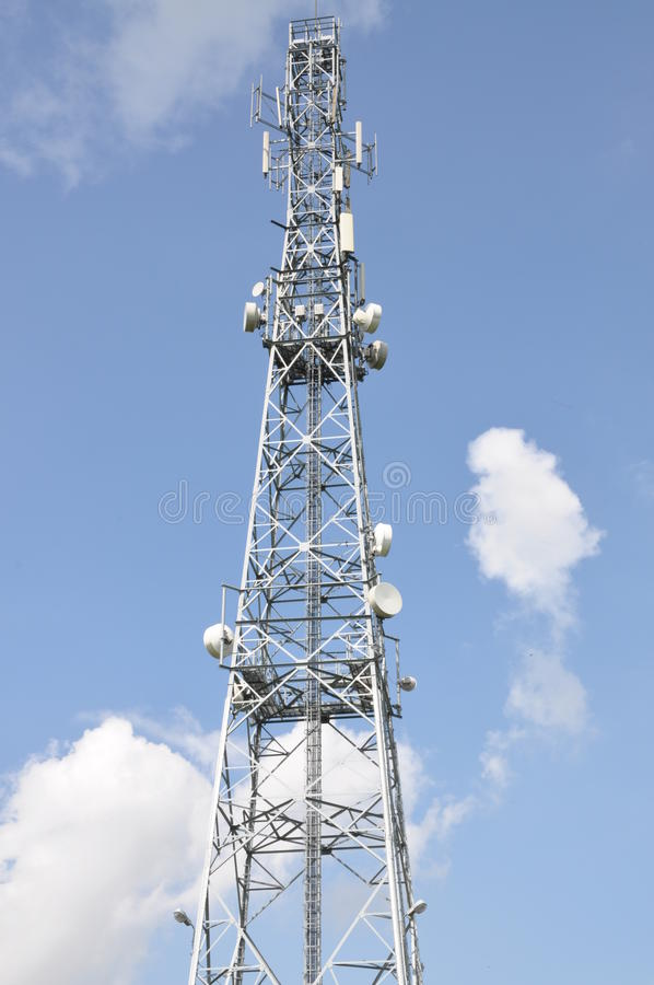 Telecommunication tower. With cell phone antennas stock images