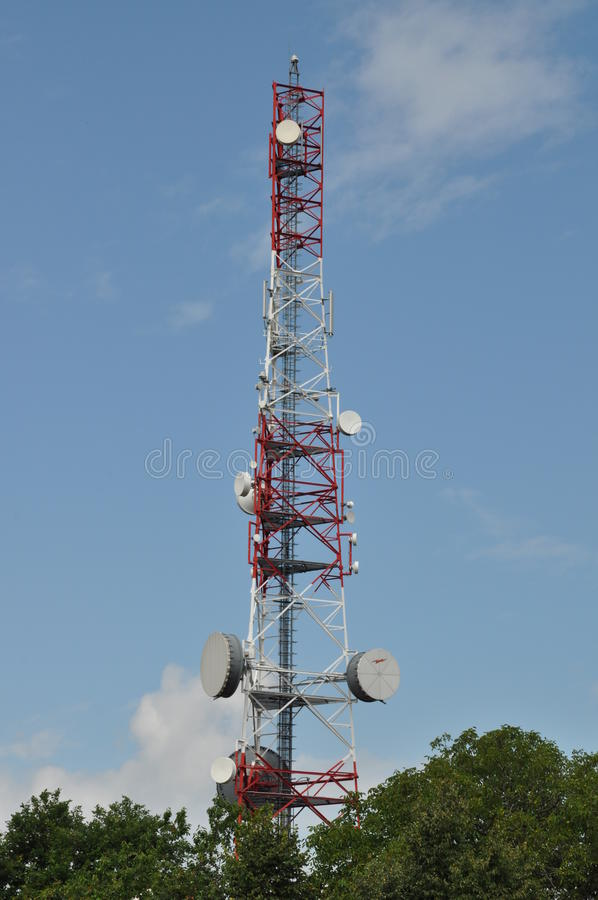Telecommunication tower. With cell phone antennas royalty free stock photography