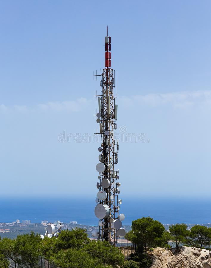 Telecommunication tower with cellular antennas on a hill. In Mallorca stock photo