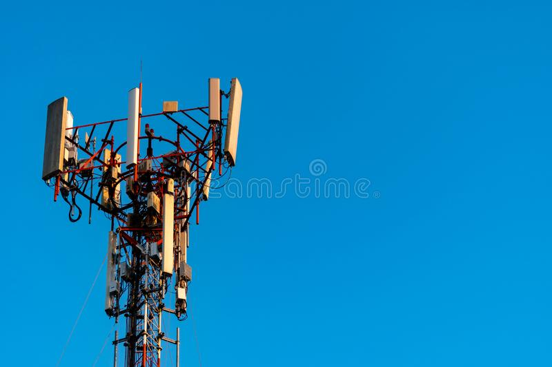 Telecommunication tower with clear blue sky background. Antenna on blue sky background. Radio and satellite pole. Communication royalty free stock images