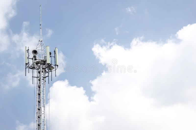 Telecommunication tower with clear blue sky background. stock photo