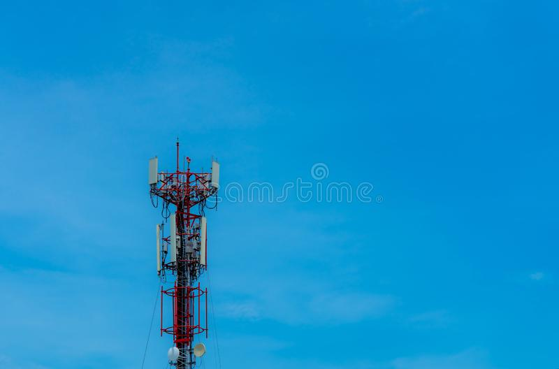 Telecommunication tower with clear blue sky background. Antenna on blue sky. Radio and satellite pole. Communication technology. royalty free stock photos