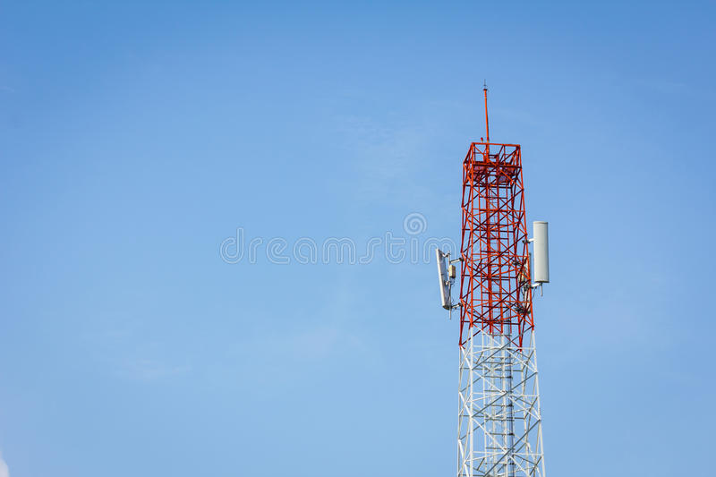 Telecommunication tower and cloudy blue sky with copyspace on th stock image