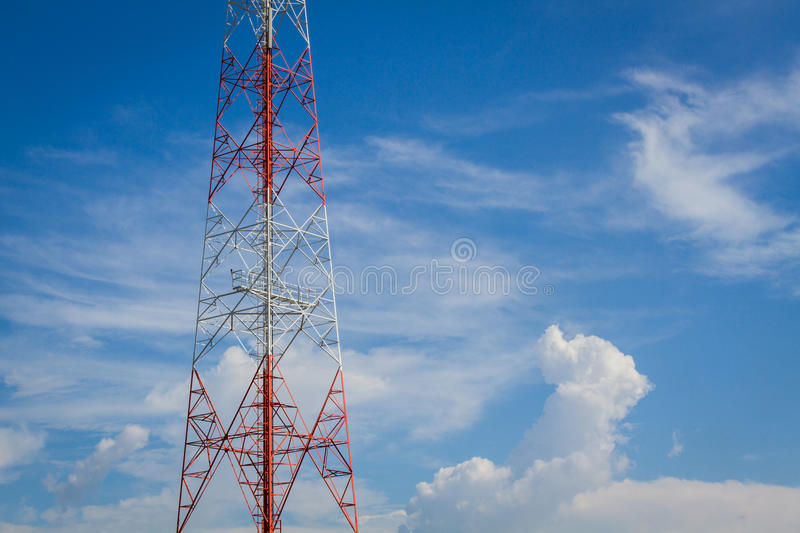 Telecommunication tower and cloudy sky with copyspace on the ri. Ght royalty free stock photos