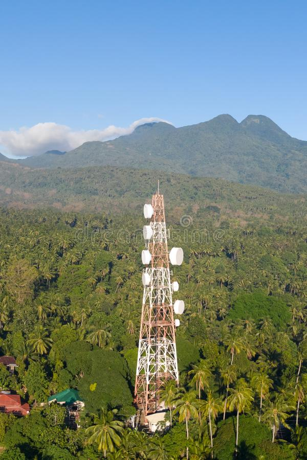 Telecommunication tower, communication antenna on Camiguin Island, Philippines. Tower with repeaters. stock photo