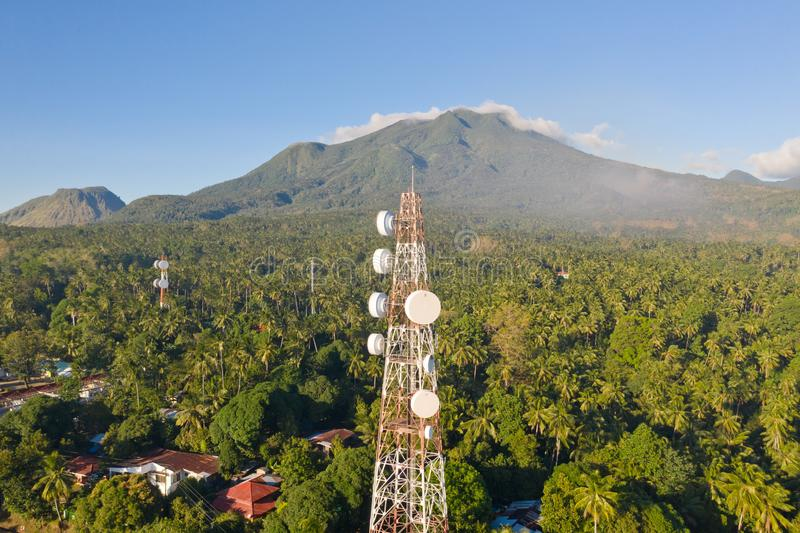 Telecommunication tower, communication antenna on Camiguin Island, Philippines. Tower with repeaters. Telecommunication tower, communication antenna on Camiguin royalty free stock photo