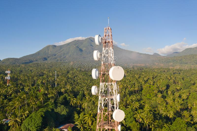 Telecommunication tower, communication antenna on Camiguin Island, Philippines. Tower with repeaters. Telecommunication tower, communication antenna on Camiguin stock photo