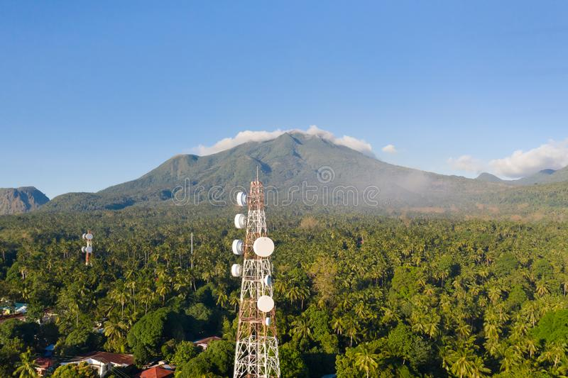 Telecommunication tower, communication antenna on Camiguin Island, Philippines. Tower with repeaters. Telecommunication tower, communication antenna on Camiguin royalty free stock photography