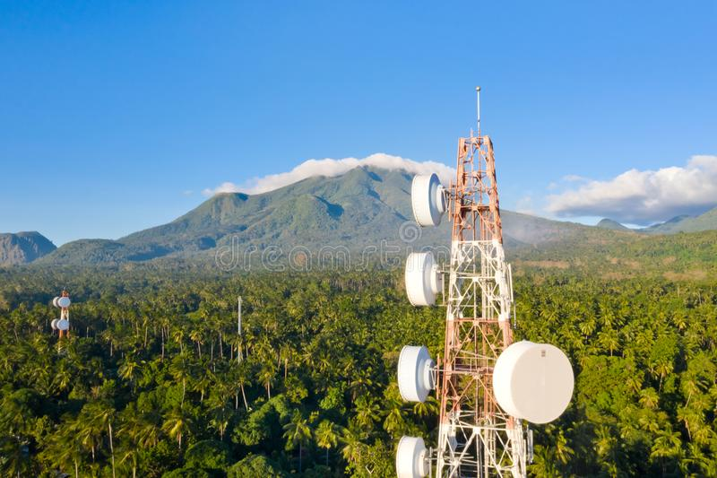 Telecommunication tower, communication antenna on Camiguin Island, Philippines. Tower with repeaters. Telecommunication tower, communication antenna on Camiguin royalty free stock images