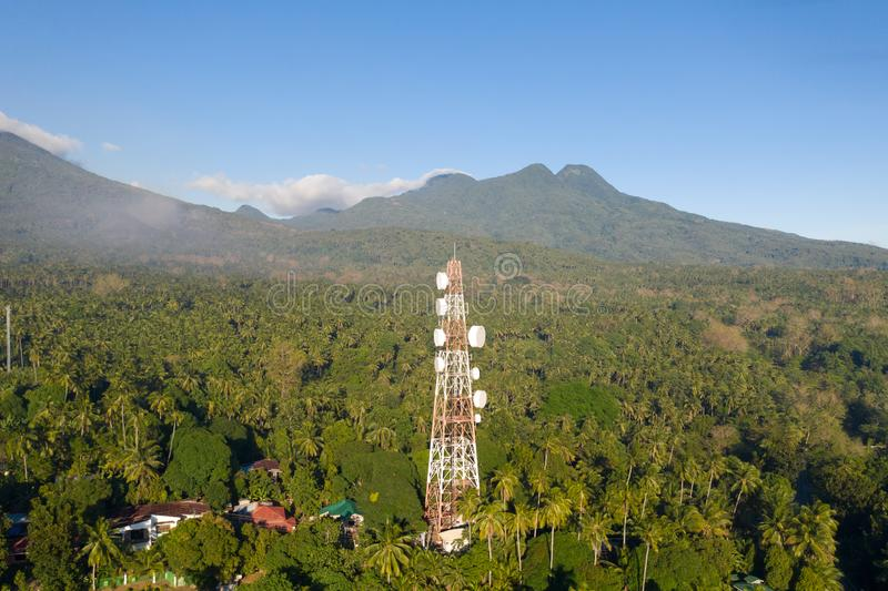 Telecommunication tower, communication antenna on Camiguin Island, Philippines. Tower with repeaters. Telecommunication tower, communication antenna on Camiguin royalty free stock image